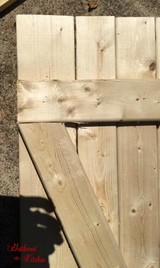 wooden barn door laying on ground