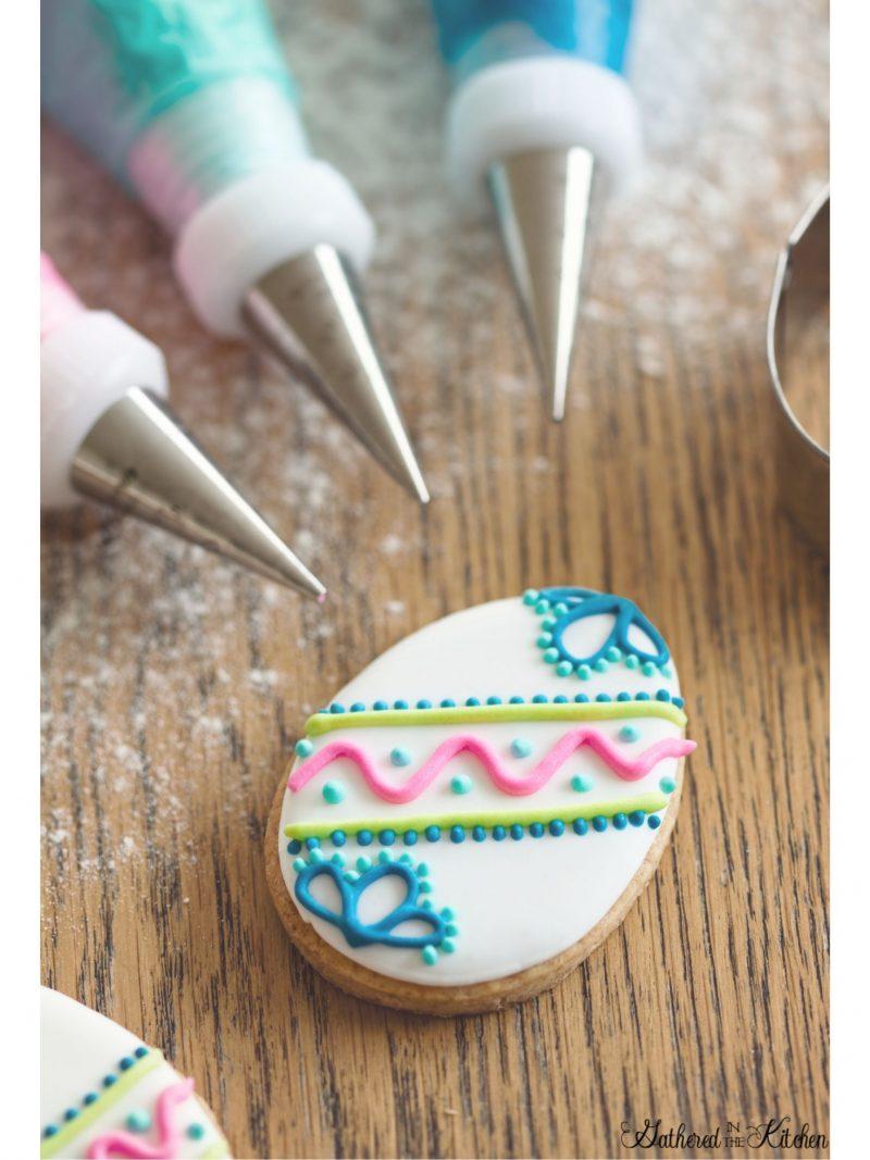 royal icing decorating egg shaped sugar cookie