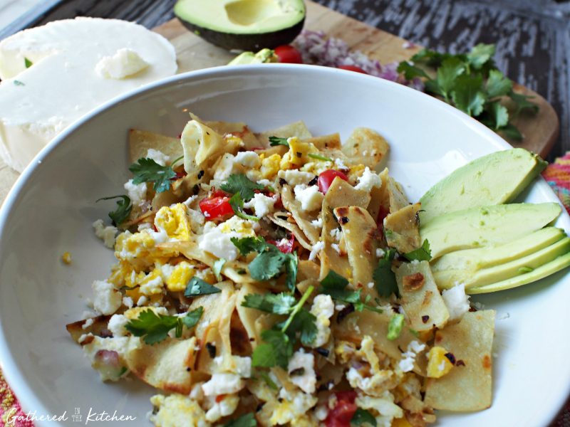Breakfast migas are a Mexican styled breakfast in skillet or taco form featuring eggs, vegetables and cheese.