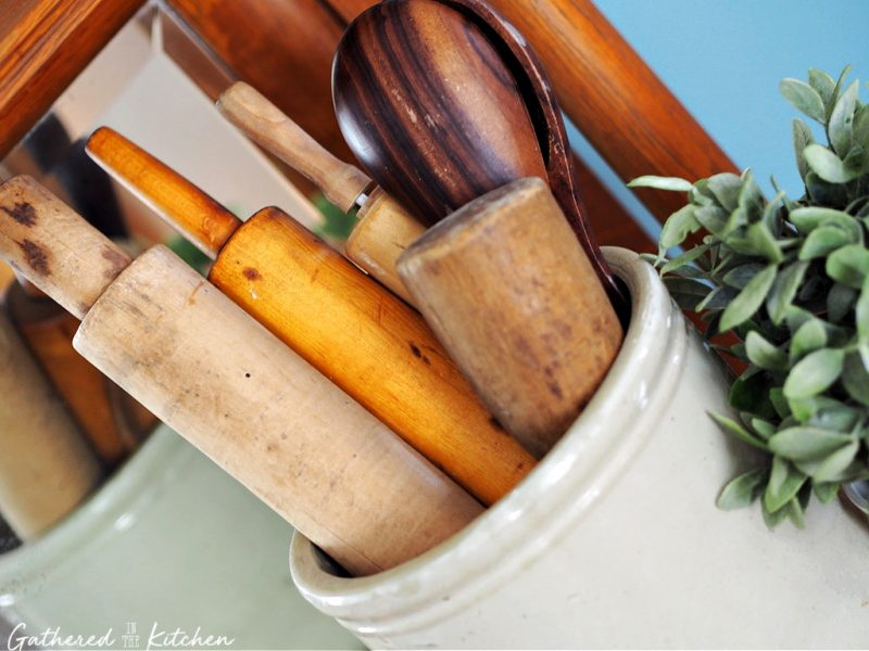 crock with antique rolling pins