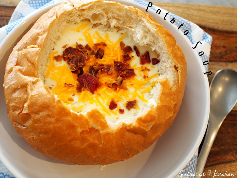 Homemade Potato Soup in a Bread Bowl topped with cheese and bacon chunks