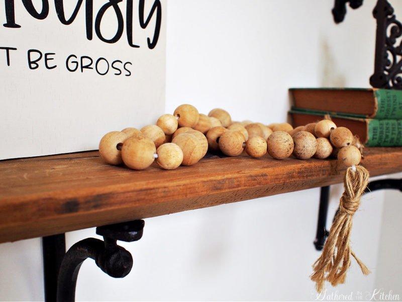 Wood Bead Garland with tassels on shelf