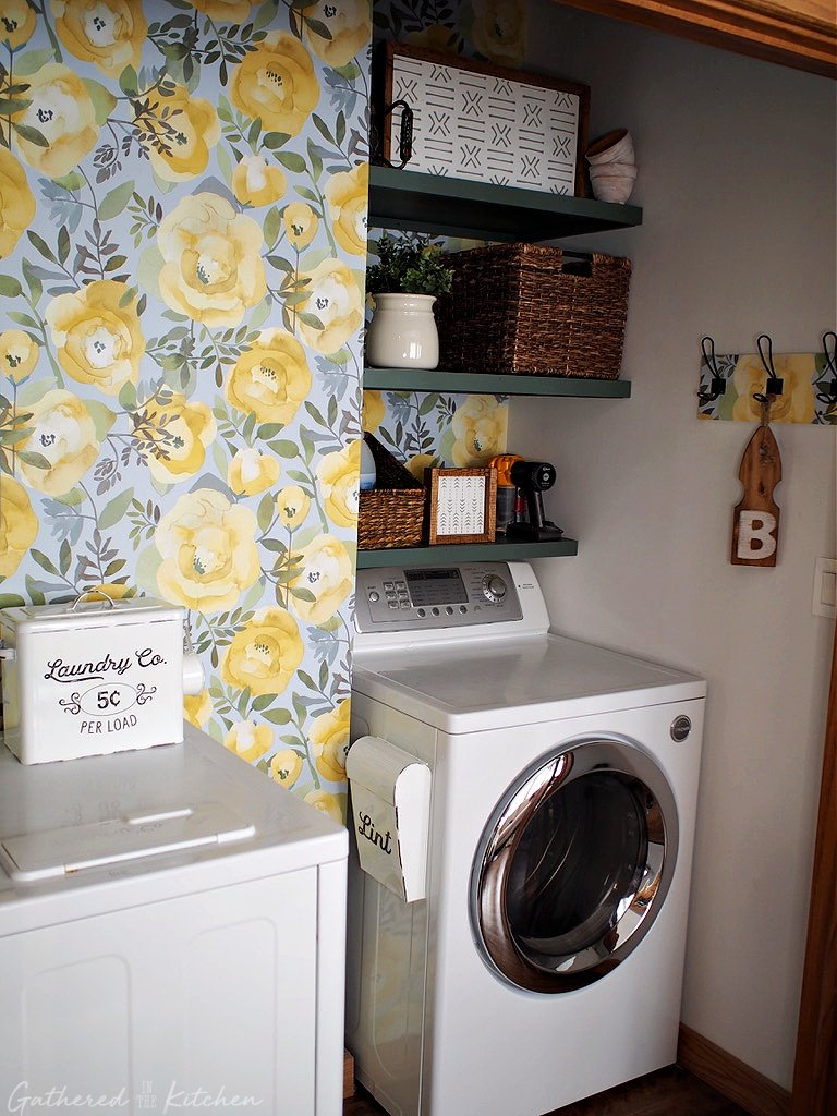 laundry room with floral wallpaper and open shelves