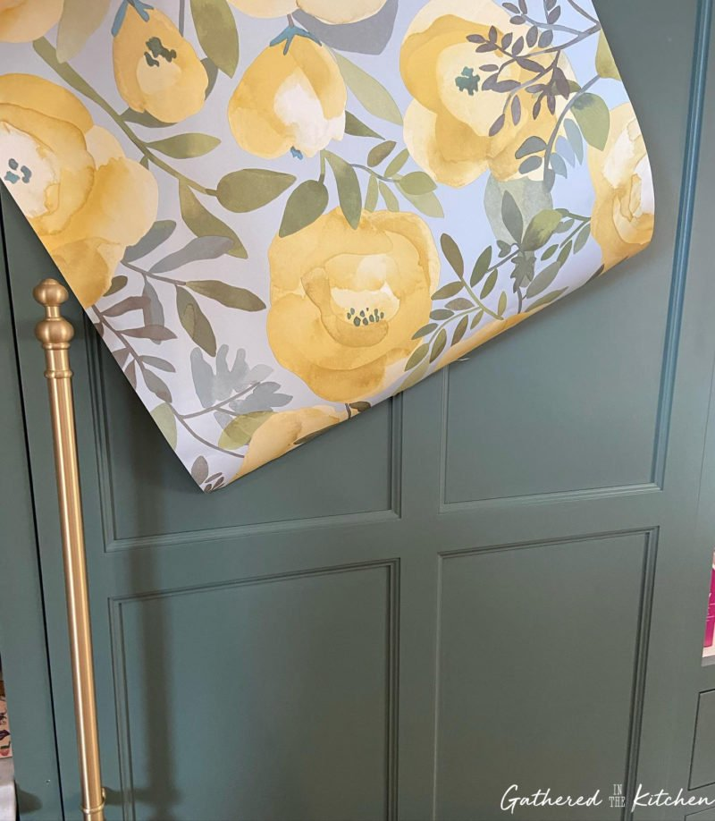 green cabinet floral wallpaper and brushed gold cabinet handle