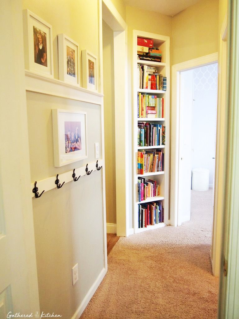 hallway with shelves and hooks