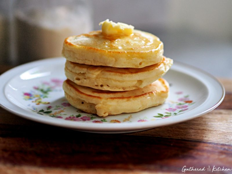 stack of homemade pancakes with melted butter