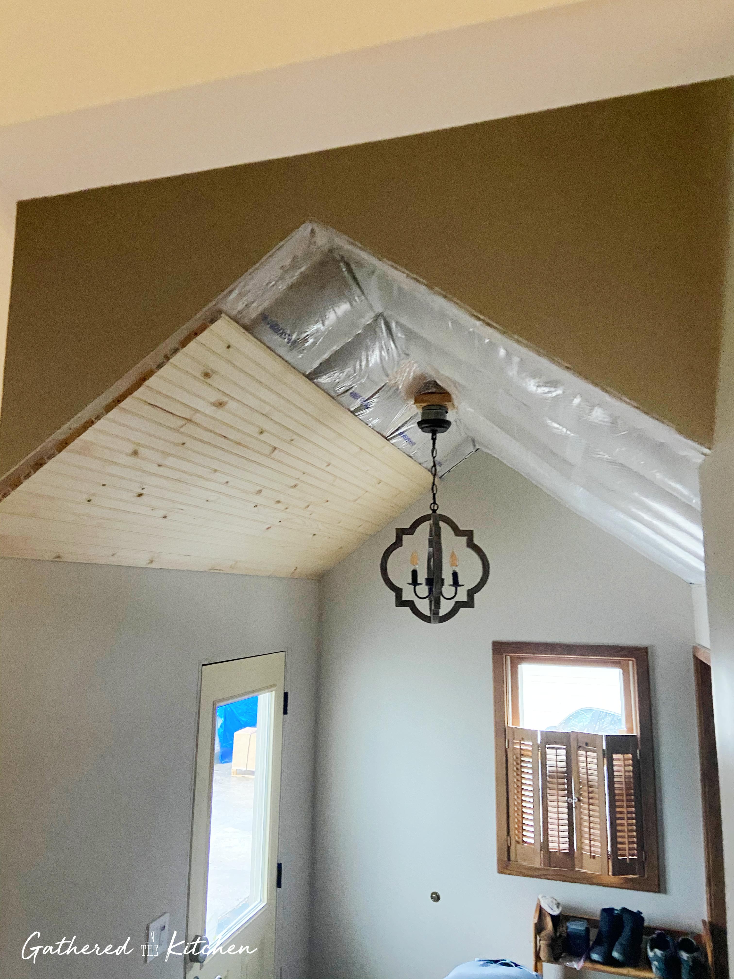 Beadboard ceiling in vaulted mudroom