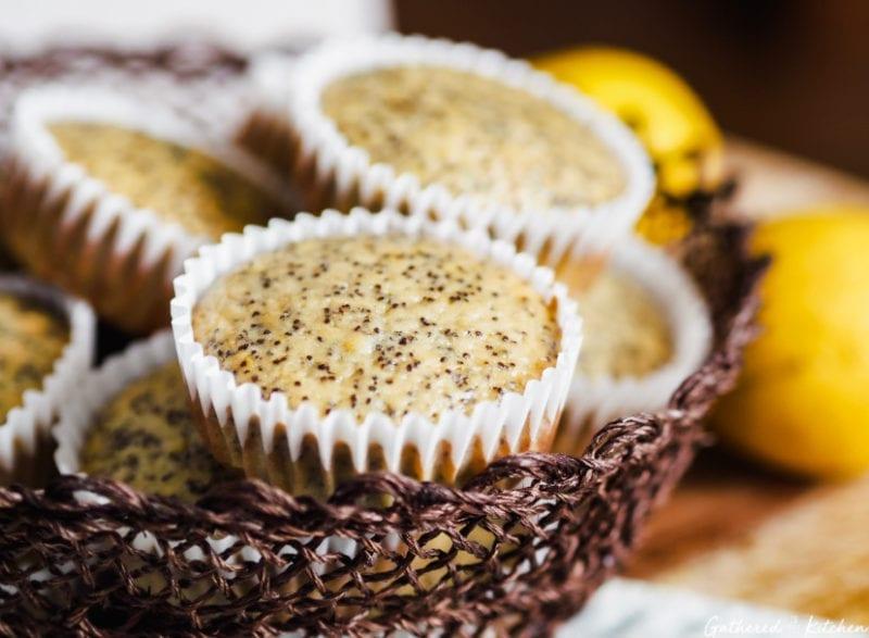 lemon poppy seed muffins in wrapper sitting in wicker basket