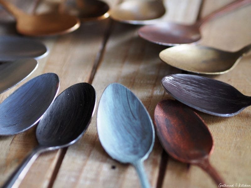 painted spoons on wooden tray