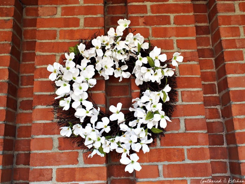 exterior brick chimney with white floral wreath