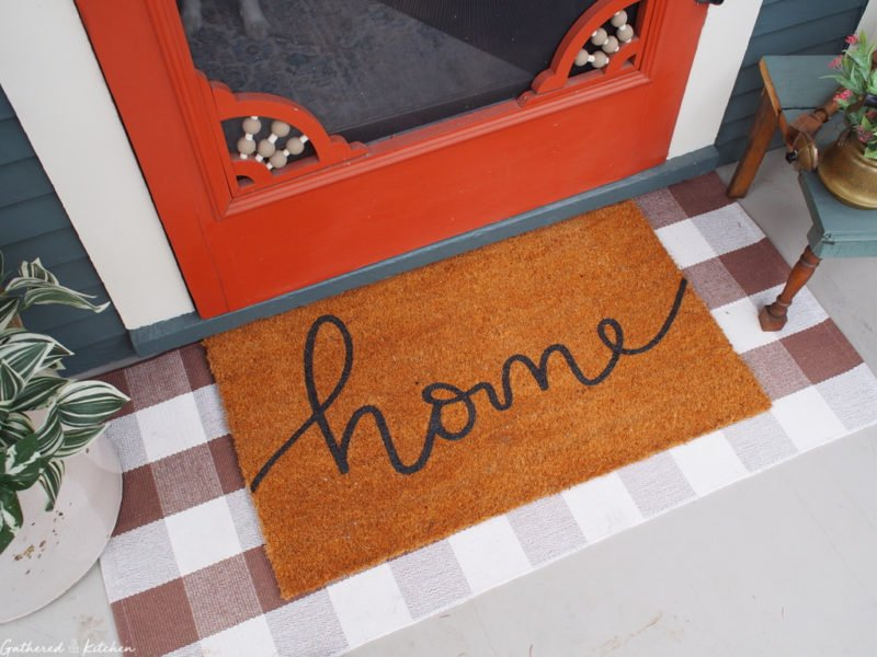 buffalo check front door mat with home mat on top