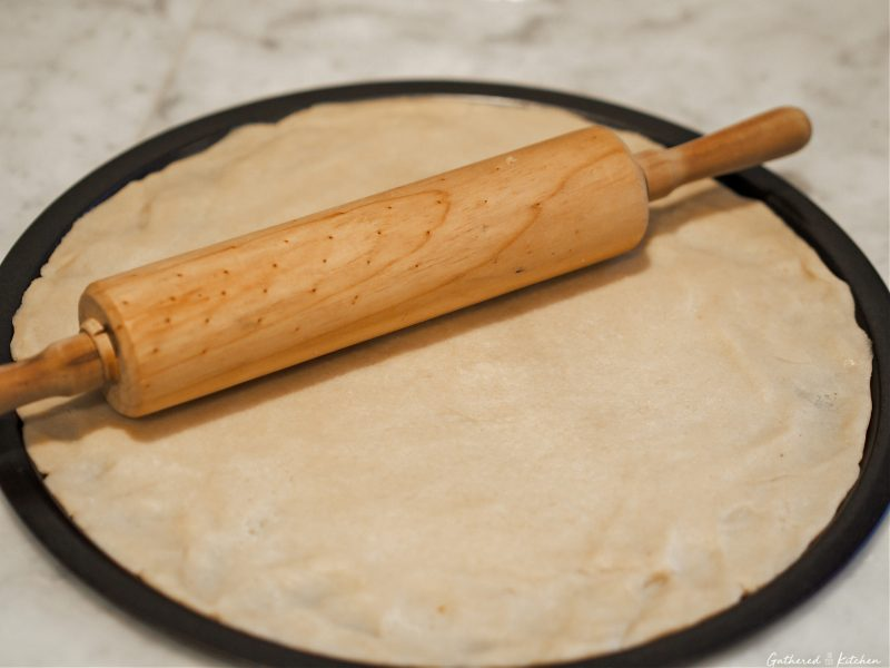 pie crust on pan with rolling pin
