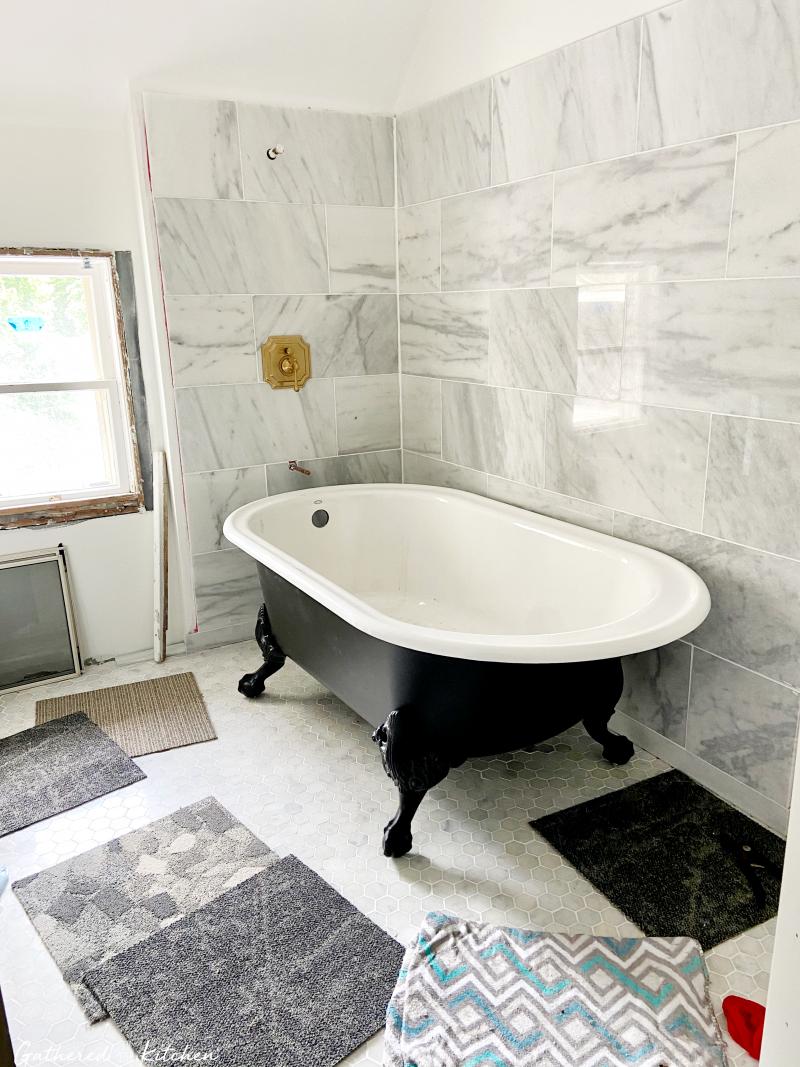 Clawfoot Tub in marble floor and wall bathroom