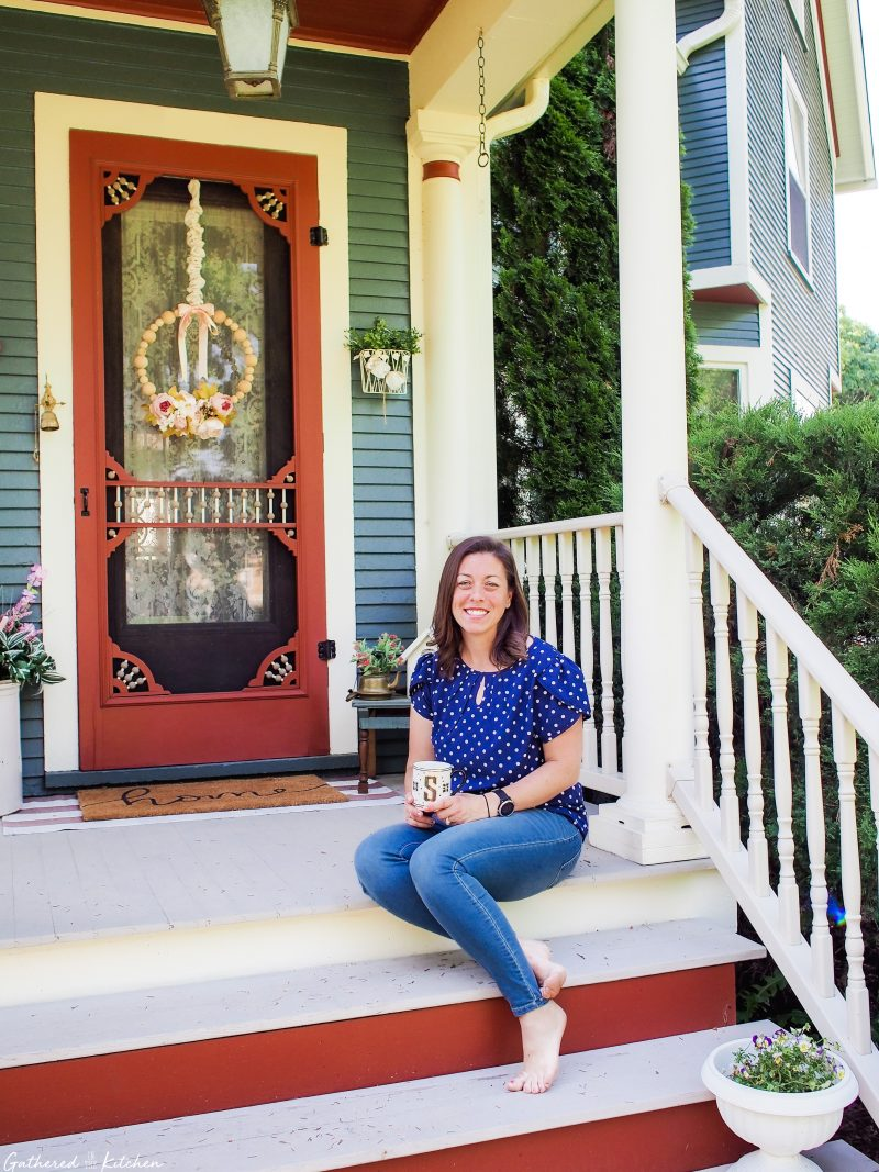 stephanie bruce sitting on porch of 1886 victorian home