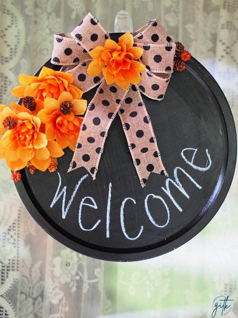 fall welcome wreath out of a dollar tree pizza pan