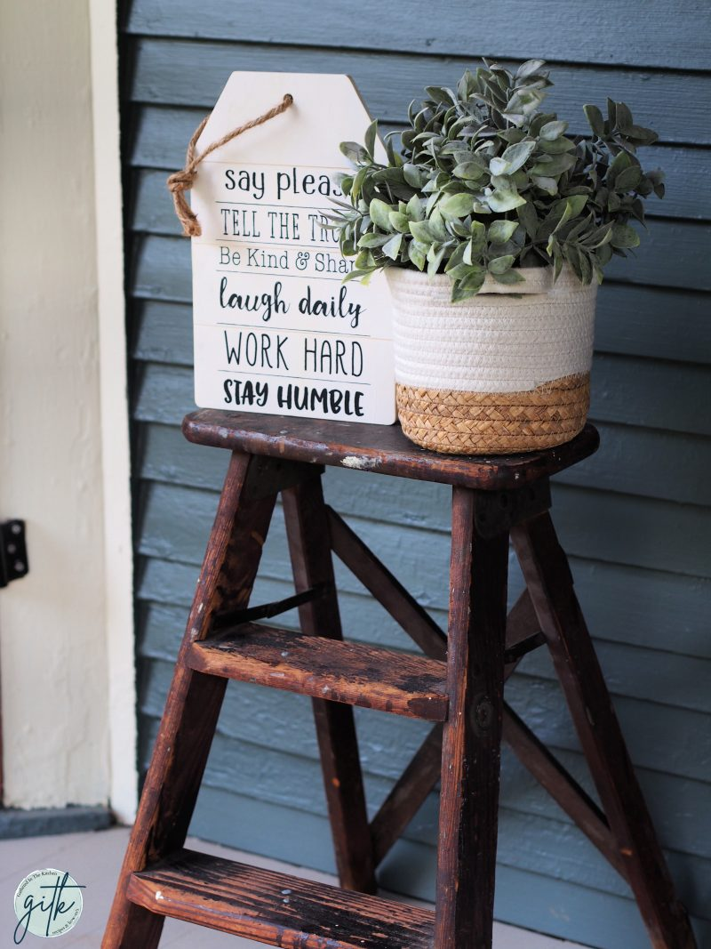 farmhouse wooden sign decor with ladder and plant