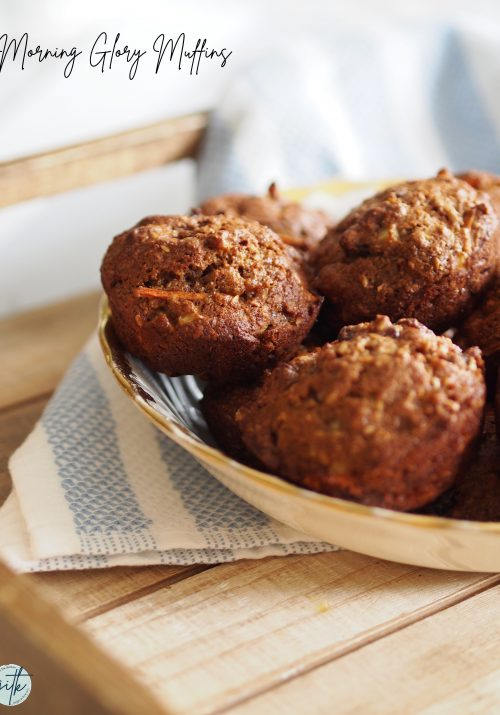 morning glory muffins in bowl on wooden table