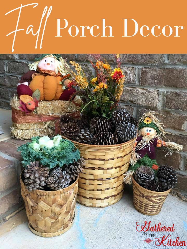 Fall Porch Decor with scarecrows, pinecones, bale of hay, wicker baskets and artificial flowers