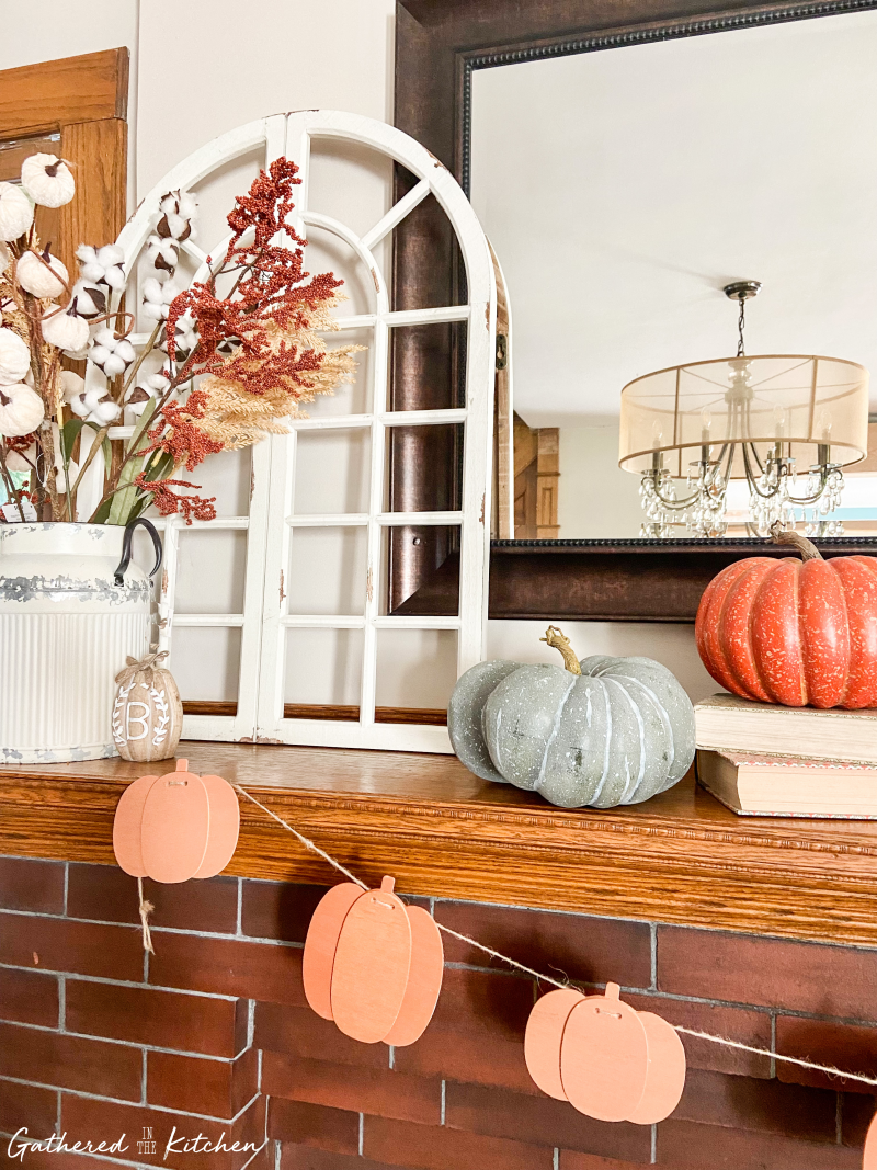 farmhouse fall decor with Floral arrangement with faux pumpkins