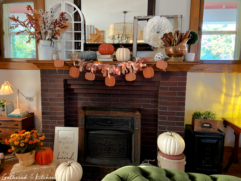 victorian living room decorated for fall