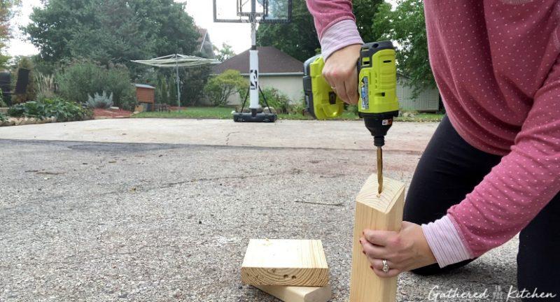 drilling hole in scrap wood using ryobi power drill